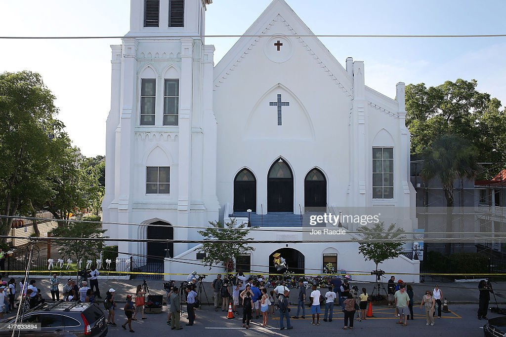 People stand outside the Emanuel AME Church after a mass shooting at the church that killed nine people on June 18 in Charleston South Carolina A...