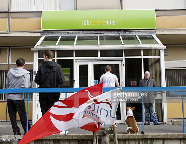 People stand outside the Job Centre in Chatham in southeast England on March 19 2009 Recessionhit Britain took a fresh blow Wednesday as official...