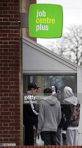 People stand outside the Jobcentre Plus on January 18 2012 in Trowbridge England Figures released today show that the UK unemployment rate has risen...