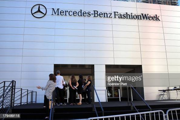 People stand outside the main tent at New York Fashion Week at Lincoln Center which officially begins tomorrow on September 4 2013 in New York City...