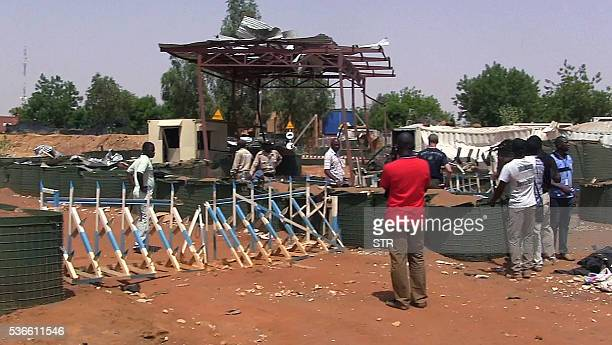 People stand stand in front of Chinese United Nations peacekeeping forces camp on June 1 2016 in Gao after AlQaeda's North African affiliate AQIM...