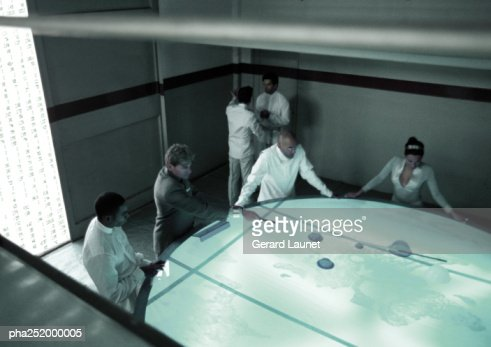 People standing around table, high angle view