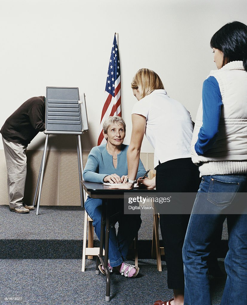 People Standing in a Line Waiting to Vote at a Polling Station