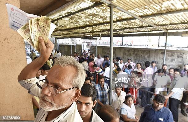 People standing in a queue to pay the bills of BEST as they were accepting old currency of 1000 and 500 at Wadala BEST office on November 24 2016 in...