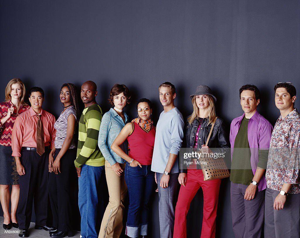 People Standing in a Row : Stock Photo