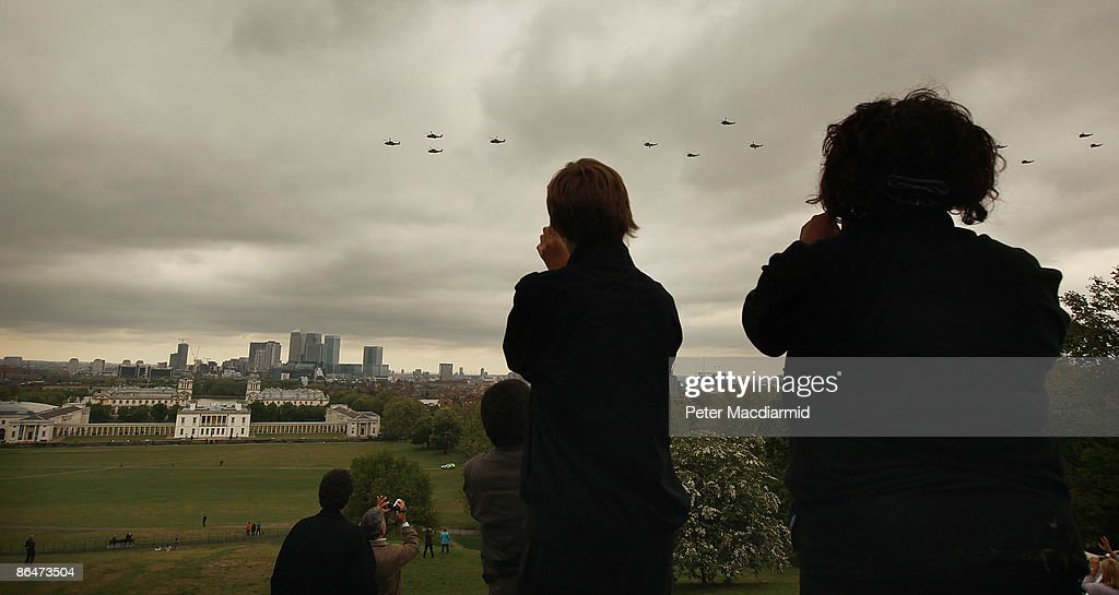 People standing in Greenwich Park watch a flypast of Royal Naval helicopters on May 7 2009 in London The Royal Navy is today begining celebrations to...