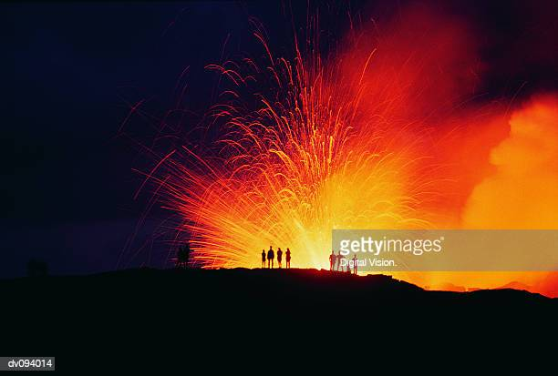 People Standing on the Edge of an Erupting Crater