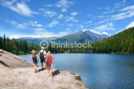 People standing on top of mountain  looking at beautiful landscape. : Stock Photo