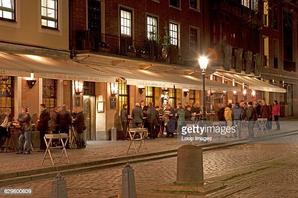 People standing outside the Uerige brewery in the Old Town of Dusseldorf Dusseldorf Germany
