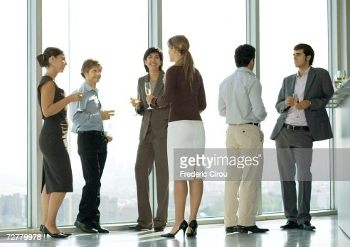 People standing with glasses during office party : Stock Photo