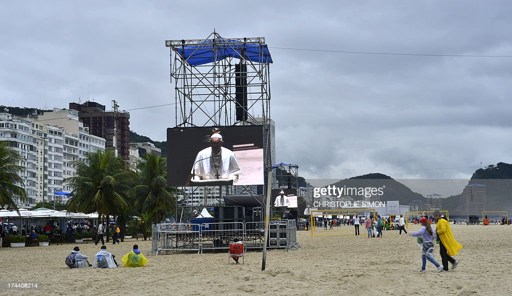 People start gathering at Copacabana beach where in the evening Pope Francis will be officially welcomed by crowds of young Catholics attending World Youth Day (WYD) on July 25, 2013. Pope Francis urged young Brazilians not to despair in the battle against corruption Thursday as he addressed their country's political problems in the wake of massive protests.