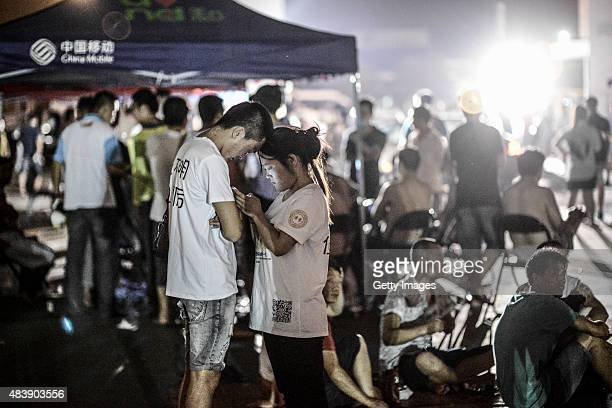 People stay at the emergency shelter set at a primary school on August 13 2015 in Tianjin China Over 500 injured and evacuated people stay at the...
