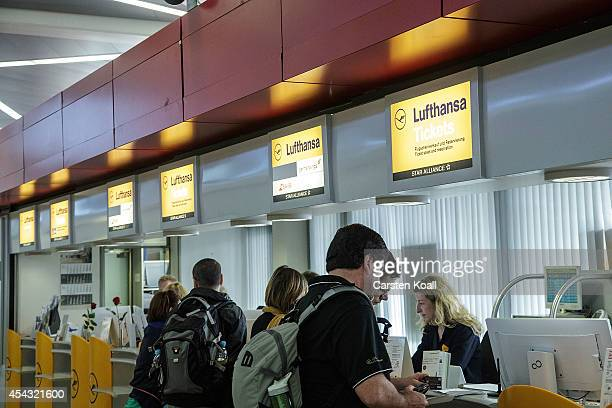 People stay in front of a Germanwings information Counter during a nationwide 6hour strike by Germanwings pilots at Tegel Airport that grounded 116...