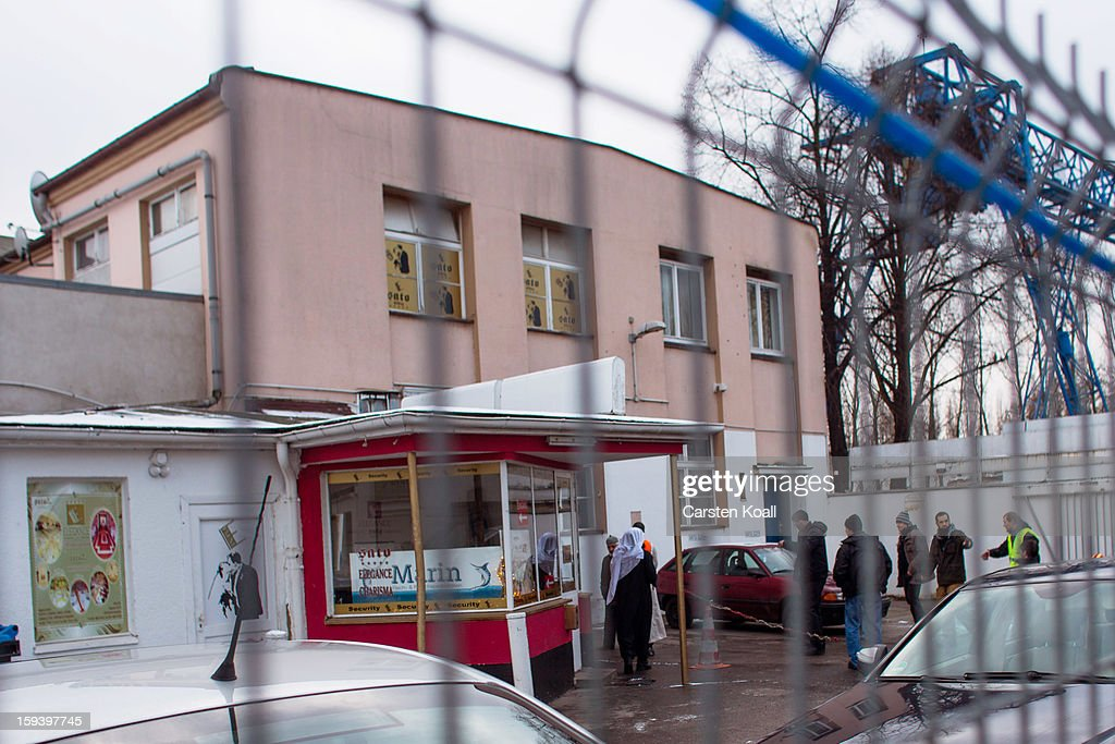 People stay outside a building where Salafite supporters were meeting on January 13, 2013 in Berlin, Germany. The Salafites had originally planned to hold a public gathering in the city center to raise money for Muslims in Syria which included prominent speakers such as radical Islamic preacher Pierre Vogel. They then moved the event to a private gathering in Neukoelln district. Salafites are an ultra-conservative group of Muslim Sunnis with hundreds of members in Berlin and the area around Bonn and Cologne. German authorities are keeping a close eye on the group, especially since clashes that broke out last year in which Salafite demonstrators attacked police and right-wing counter-demonstrators.