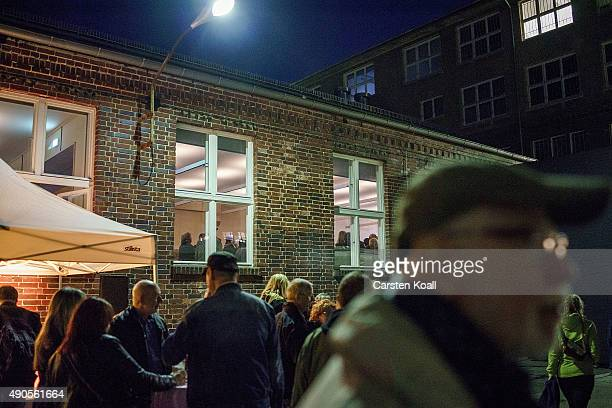 People stay outside as the former East German rock band 'Speiches Monokel' performs at the Hohenschoenhausen memorial and former prison of the East...