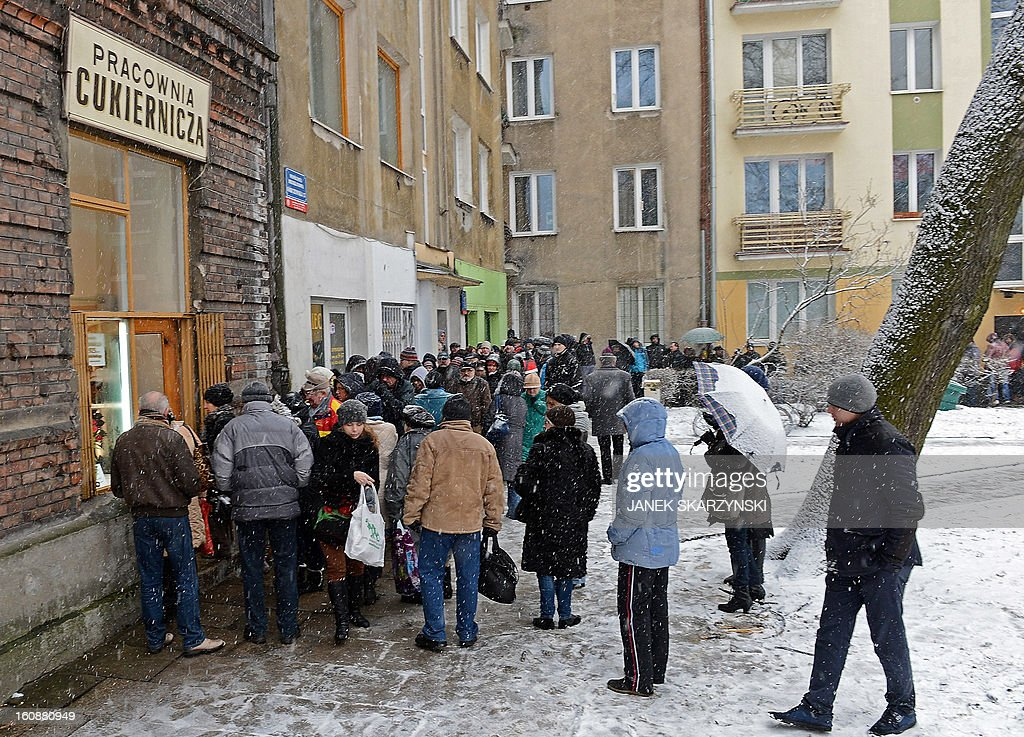 People stood in line for some six hours in sub-freezing temperatures in front of a popular sweet shop in Warsaw to get the cakes, jam-filled doughnut Paczki traditionally eaten on the Thursday of Carnival, the Fat Thursday on February 7, 2013.