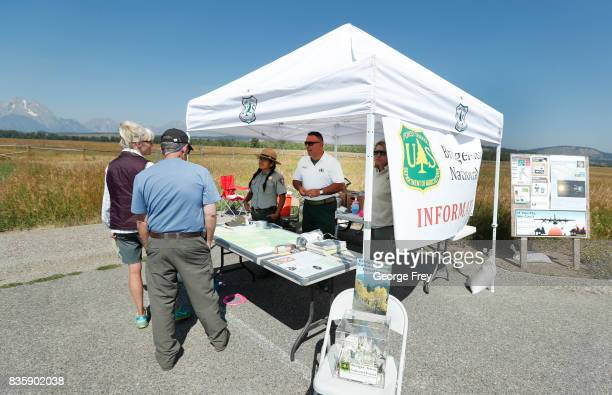 People stop at a roadside information center to get information on the solar eclipse in Grand Teton National Park on August 20 2017 outside Jackson...