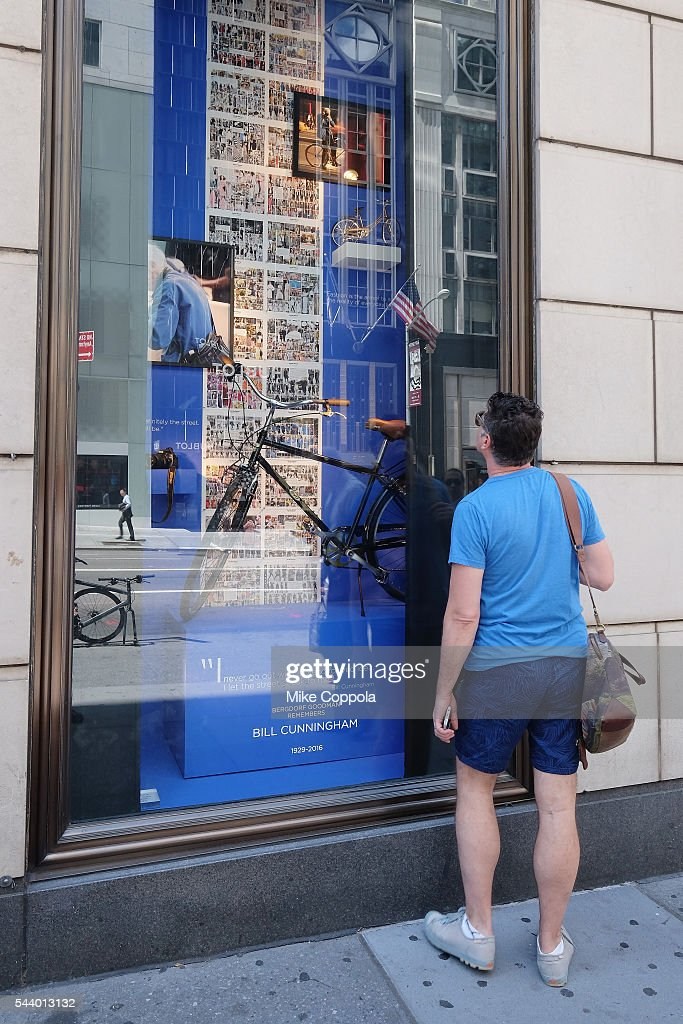 People stop to look at a tribute to photographer Bill Cunningham that is set up in a window at Bergdorf Goodman on June 30, 2016 in New York City. Cunningham passed away at the age of 87 on Saturday, June 25th in Manhattan.