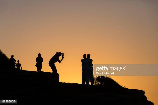 People stop to take photos of the installation 'Under One Sky' by Stephan Marr at Sculptures By The Sea at Bondi Beach on October 19 2017 in Sydney...