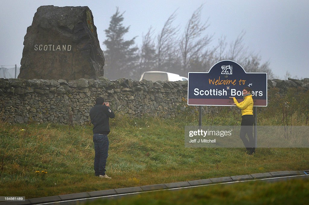 People stop to take pictures at Carter Bar view point where the A68 crosses from Scotland into England on October 22, 2012 in Carter Bar, Scotland. Last week Scottish First Minister Alex Salmond met with British Prime Minister David Cameron and agreed on details for a Scottish independence referendum to be held in the autumn of 2014 asking a single yes or no question on whether the country should become independent.
