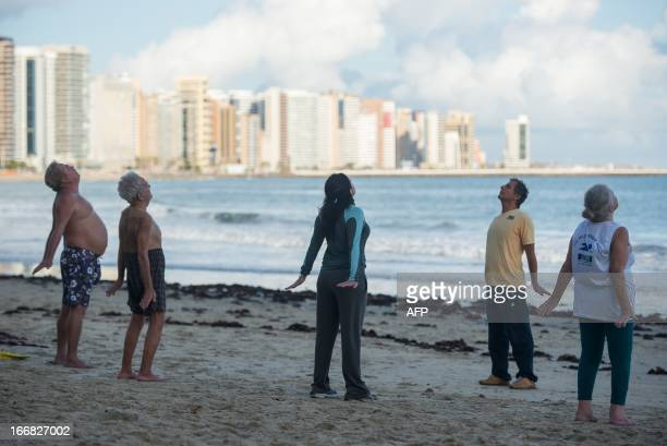 People stretch out on the beach in Fortaleza of Ceara State in northeastern Brazil on April 17 2013 AFP PHOTO/Yasuyoshi CHIBA