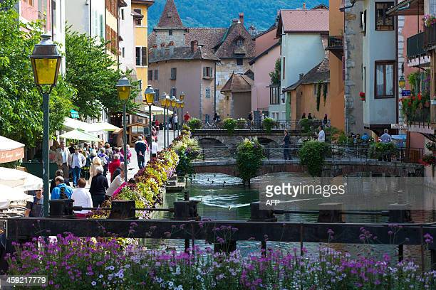 People stroll on September 11 2013 along the channel of Thiou in the old town of Annecy French Alps AFP PHOTO / PATRICE COPPEE