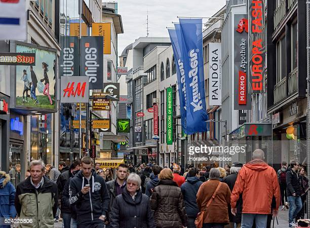 People stroll through Hohe Strasse a main shopping street in Cologne Germany 09 November 2014 Hohe Strasse starts at the foot of the cathedral and...