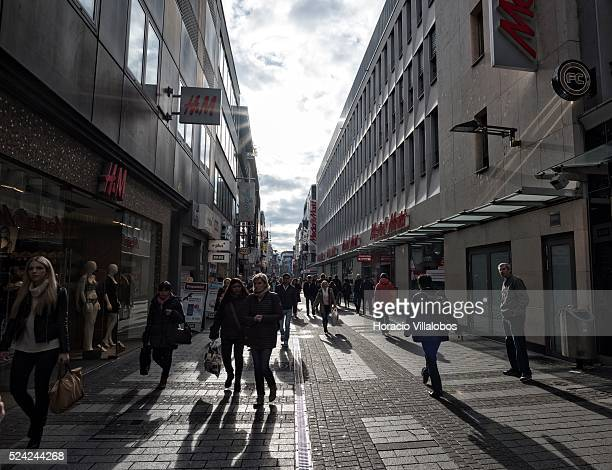 People stroll through Hohe Strasse a main shopping street in Cologne Germany 10 November 2014 Hohe Strasse starts at the foot of the cathedral and...