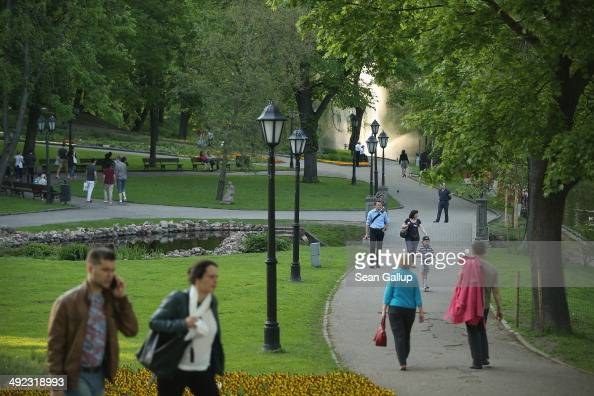 People stroll through Kronvalda park on May 19 2014 in Riga Latvia Founded in 1201 the city is a former member of the Hanseatic League and its...