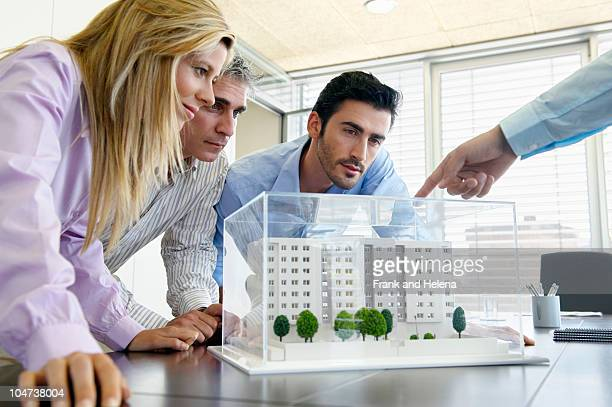 People studying architectural model