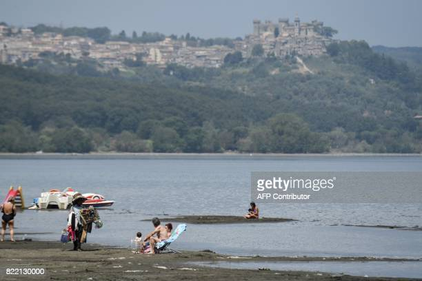 People sunbath along the shores of Lake Bracciano 32 km northwest of Rome as the Mayor of Rome decided whether or not to ration drinking water due to...