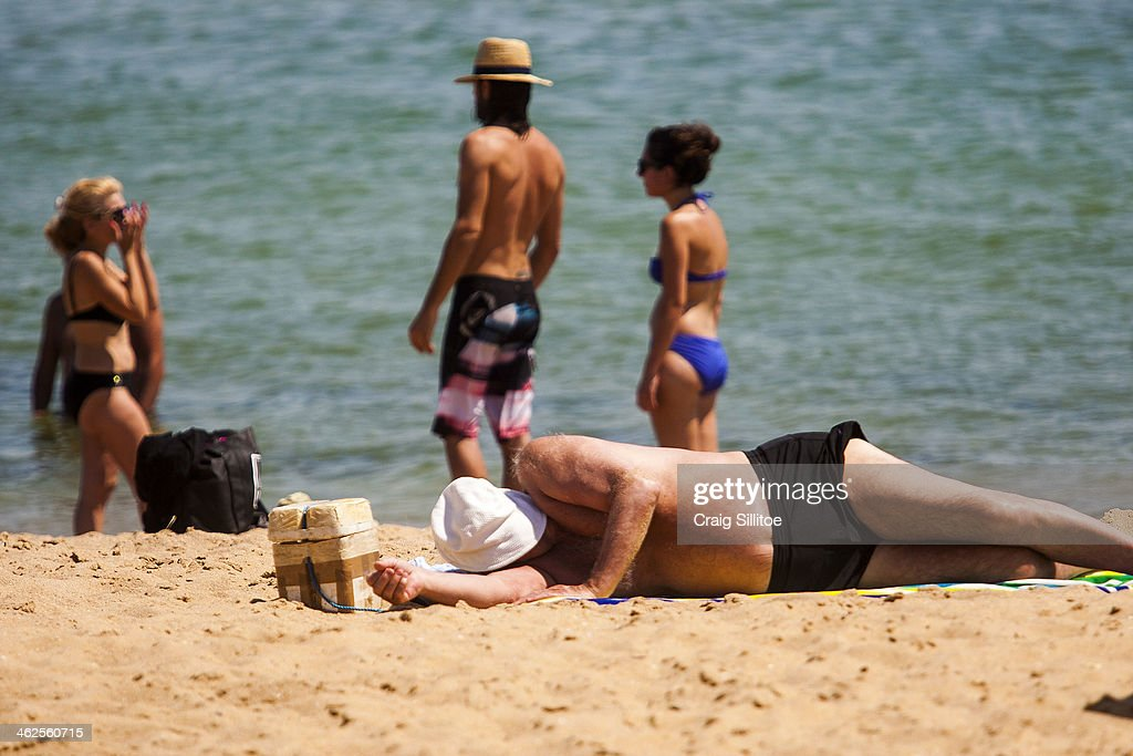 People sunbath as they enjoy the warm weather at Elwood Beach on January 14, 2014 in Melbourne, Australia. Temperatures are expected to reach over 40 degrees Celsius in parts of Victoria over the next four days.