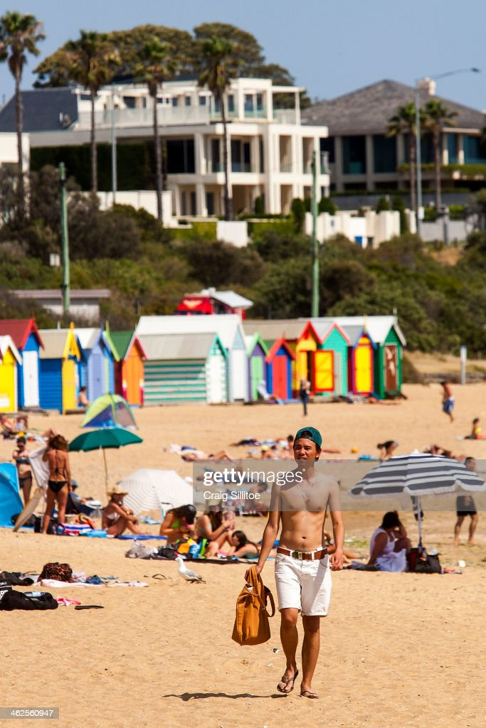 People sunbath at Brighton Beach on January 14, 2014 in Melbourne, Australia. Temperatures are expected to reach over 40 degrees Celsius in parts of Victoria over the next four days.