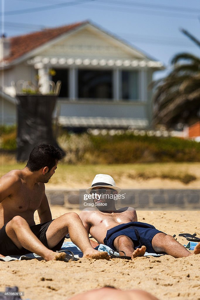 People sunbath at Elwood Beach on January 14, 2014 in Melbourne, Australia. Temperatures are expected to reach over 40 degrees Celsius in parts of Victoria over the next four days.
