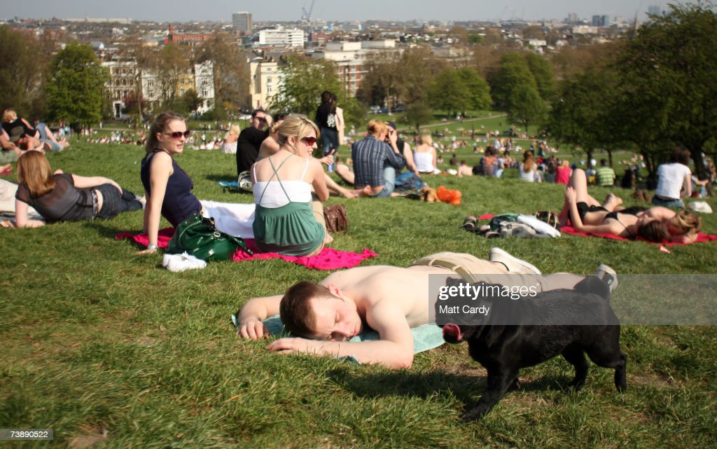 People sunbathe as they enjoy the hot weather in Primrose Hill on April 15, 2007 in London, England. The un-seasonably warm weather has heralded the start to what weather forecasters predict will be a record breaking summer.