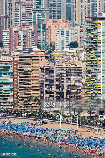 People sunbathe at Levante Beach on July 22 2015 in Benidorm Spain Spain has set a new record for visitors with 292 million visitors in June 42% more...