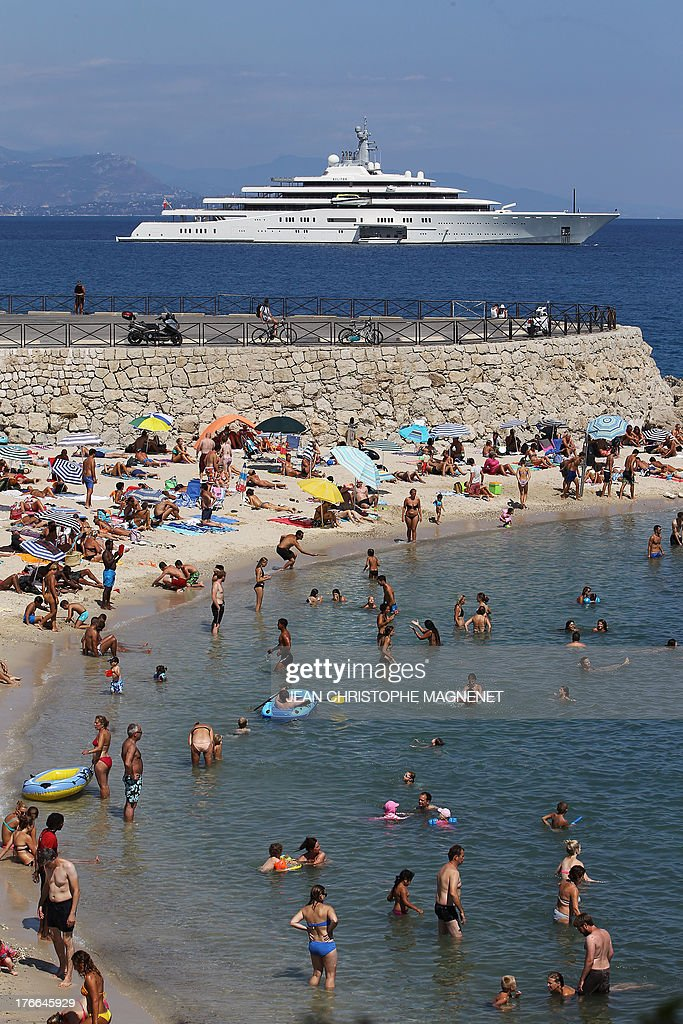People sunbathe in Antibes, on August 16, 2013, southeastern France.