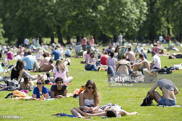 People sunbathe in the summer heat in a park in central London on June 30 2013 AFP PHOTO / JUSTIN TALLIS