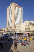 People sunbathe on the beach of Tel Aviv's Sheraton hotel as unusally warm temperatures in Israel reached 26 degrees celcius on December 27 2010 AFP...
