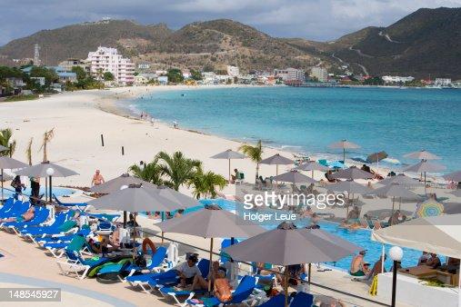People sunbathing at Great Bay Beach Hotel Pool.
