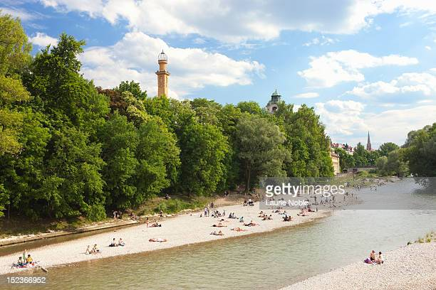 People sunbathing on the banks of the Isar