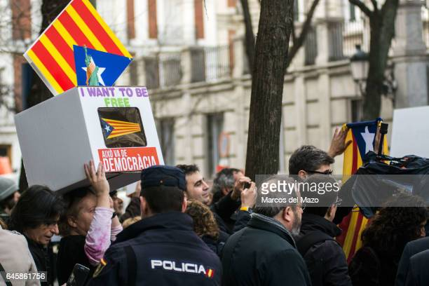 People supporting Francesc Homs as he goes to declare for allowing ballots for an independence referendum in Catalonia