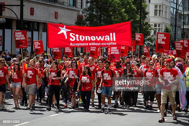 People supporting the organization Stonewall which works for the equality and justice for lesbians gay men and bisexuals during the Pride London on...