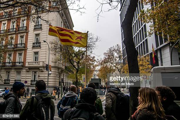 People supporting the pro independence activists who are questioned in the Spanish National Court for the burning of images of the King during a...