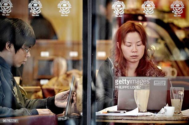 People surf the internet on a laptop using the wifi connection of a cafe in Shanghai on January 14 2010 US companies in China are worried about the...