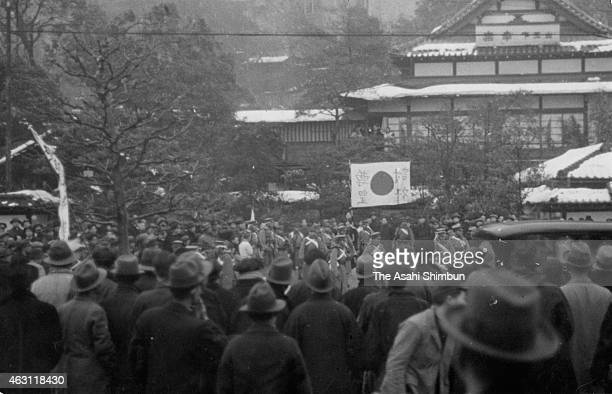 People surround rebel troops occupying the restaurant 'Koraku' during the February 26 Incident on February 26 1936 in Tokyo Japan