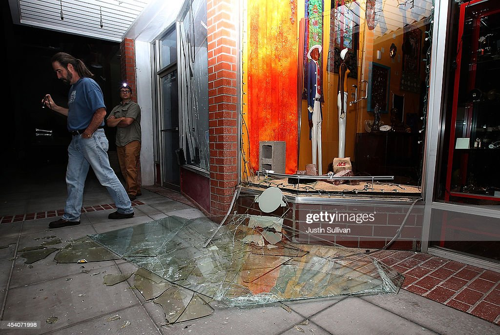 People survey a destroyed building following a reported 6.0 earthquake on August 24, 2014 in Napa, California. A 6.0 earthquake rocked the San Francisco Bay Area shortly after 3am on Sunday morning.