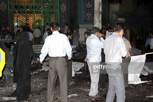 People survey the carnage outside Jameh mosque in the southeastern Iranian city of Zahedan on July 15 2010 Two suicide bombings at a Shiite mosque in...