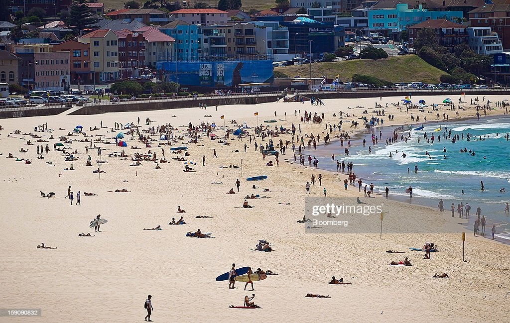 People swim and sunbathe at Bondi Beach in Sydney, Australia, on Monday, Jan. 7, 2013. The Bureau of Statistics is scheduled to release retail sales data on Jan. 9. Photographer: Ian Waldie/Bloomberg via Getty Images