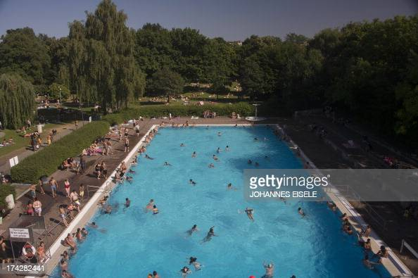 People swim in a public swimming pool on July 23 2013 in Berlin's Neukoelln district as temperatures in the capital reached 30 degrees Celsius AFP...